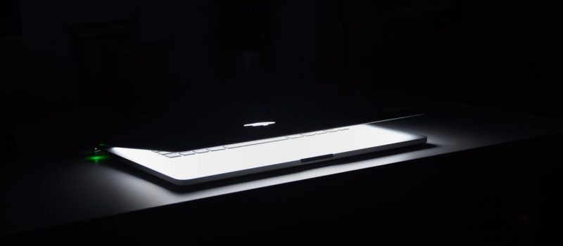 photography-of-macbook-half-opened-on-white-wooden-surface-633409 (1)